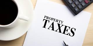 Tax implications for NRI buying property in India